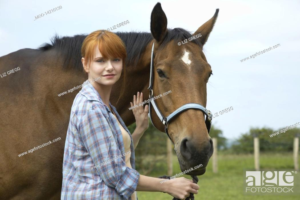 Stock Photo: Woman with horse in field portrait.