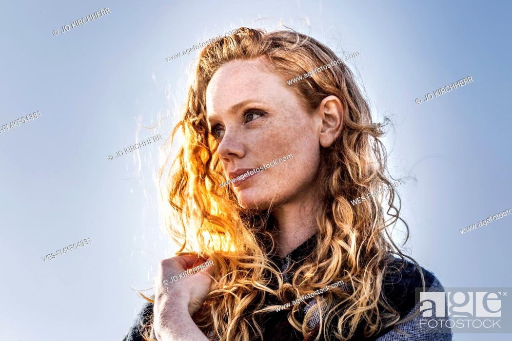 Photo de stock: Portrait of redheaded woman outdoors.