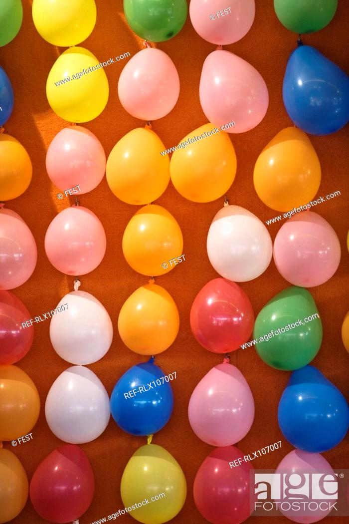 Stock Photo: Wall covered in colourful balloons at Oktoberfest, Munich, Germany.
