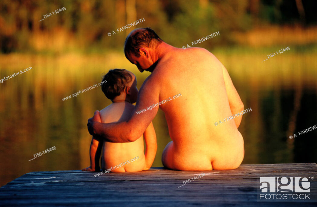 Imagen: Nude father and son on dock.