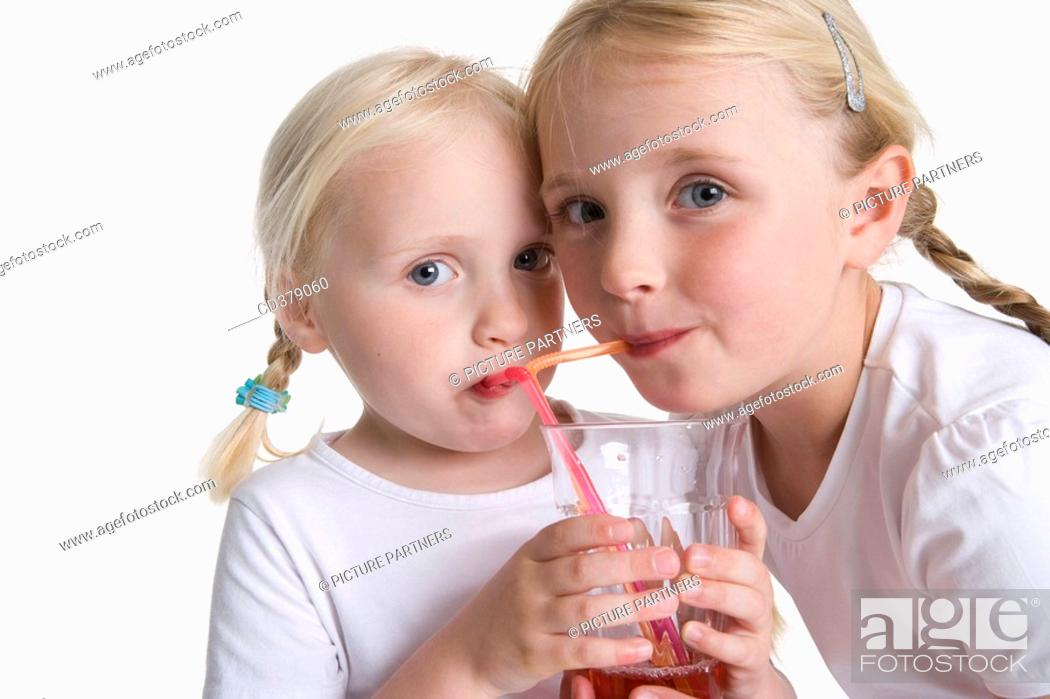 Stock Photo: Two blond girls drinking lemonade with a straw.