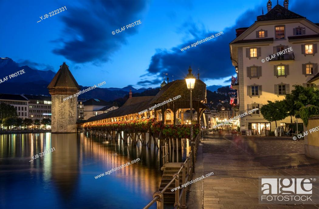 Stock Photo: Historical Chapel Bridge, a landmark at the city of Lucerne at the Lake Lucerne at night, Switzerland.