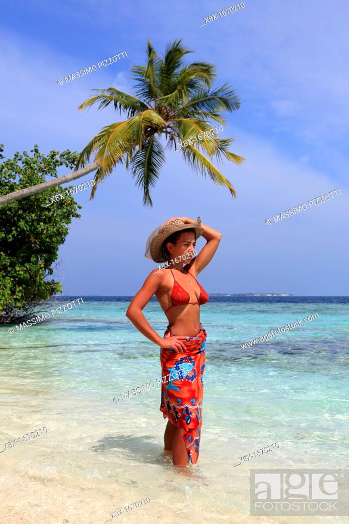 Stock Photo: Girl watching the Ocean at the seashore, Biyadhoo island, Maldives.