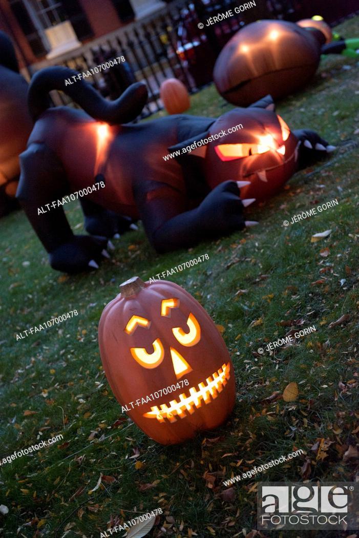 Stock Photo: Illuminated jack-o-lantern and Halloween decorations.