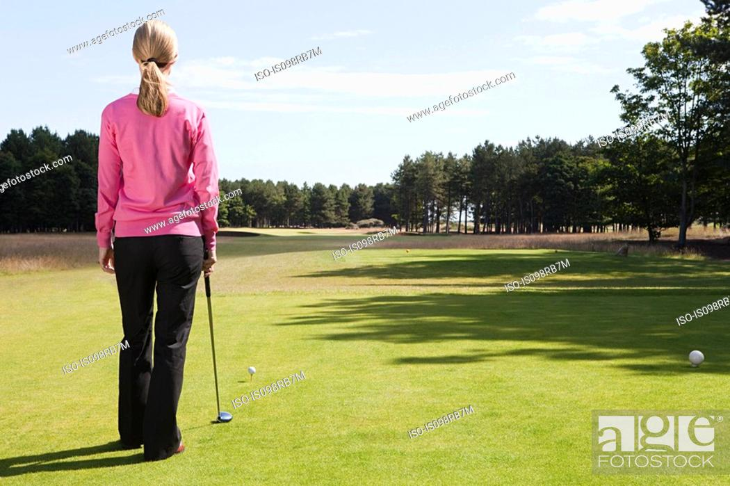 Stock Photo: Female golfer on the fairway.