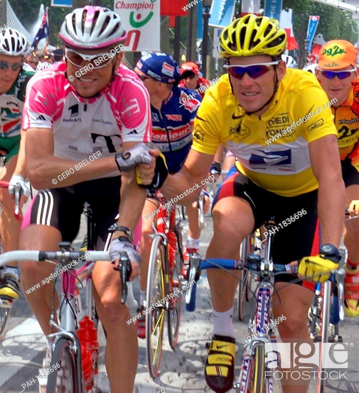 Stock Photo - German bicycle racer Jan Ullrich (l) congratulates US cycler Lance  Armstrong on the 23rd of July in 2000. Armstrong won the Tour de France 115788ab7