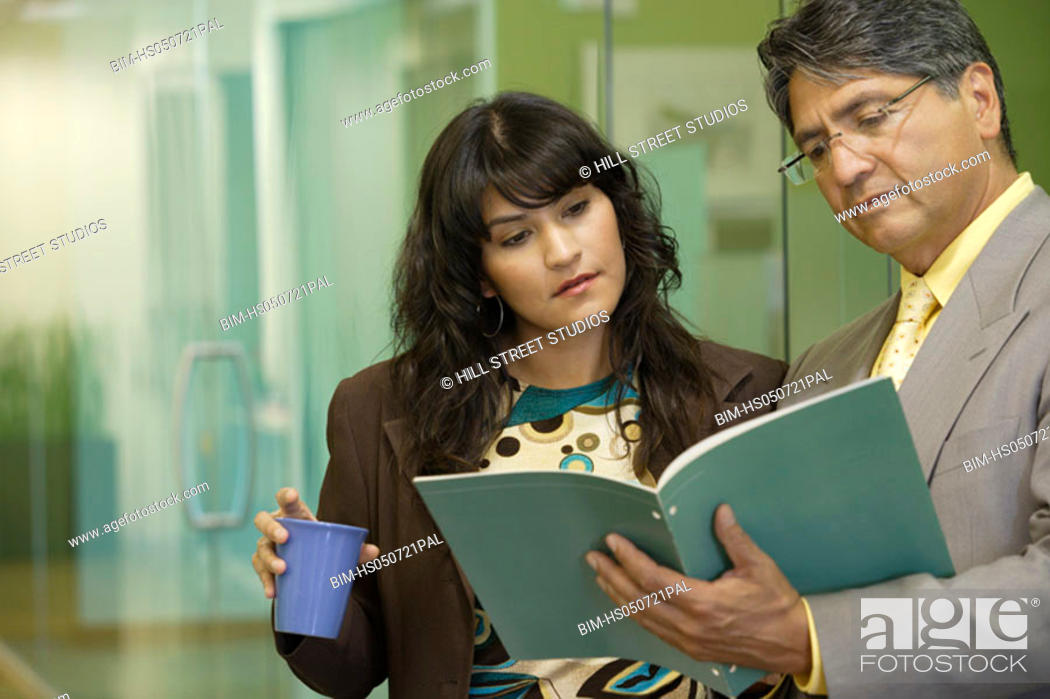 Stock Photo: Businessman showing colleague a folder.