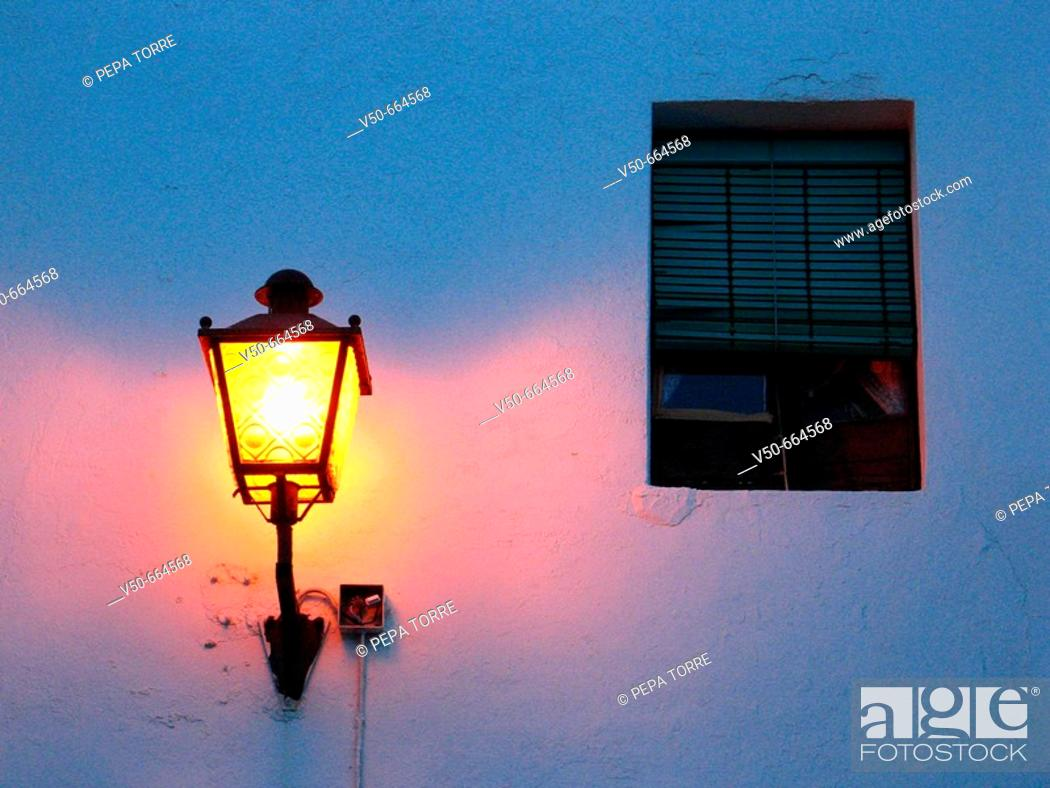 Stock Photo: Street lamp in a street at night. Conil de la Frontera. Cádiz province. Andalucía. Spain.