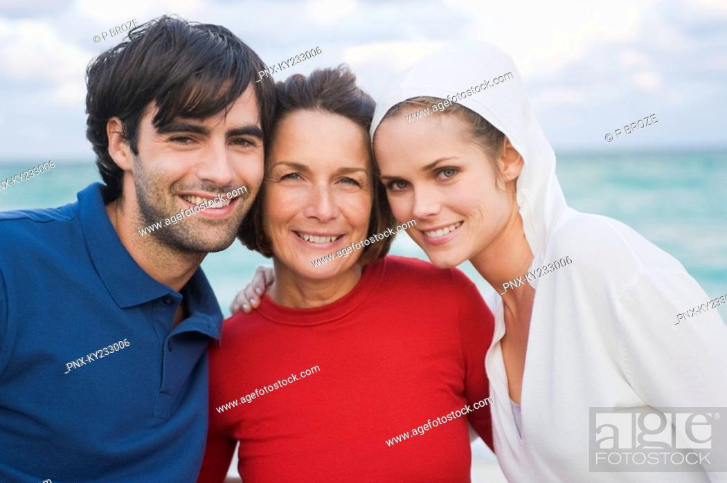 Stock Photo: Portrait of a family smiling.