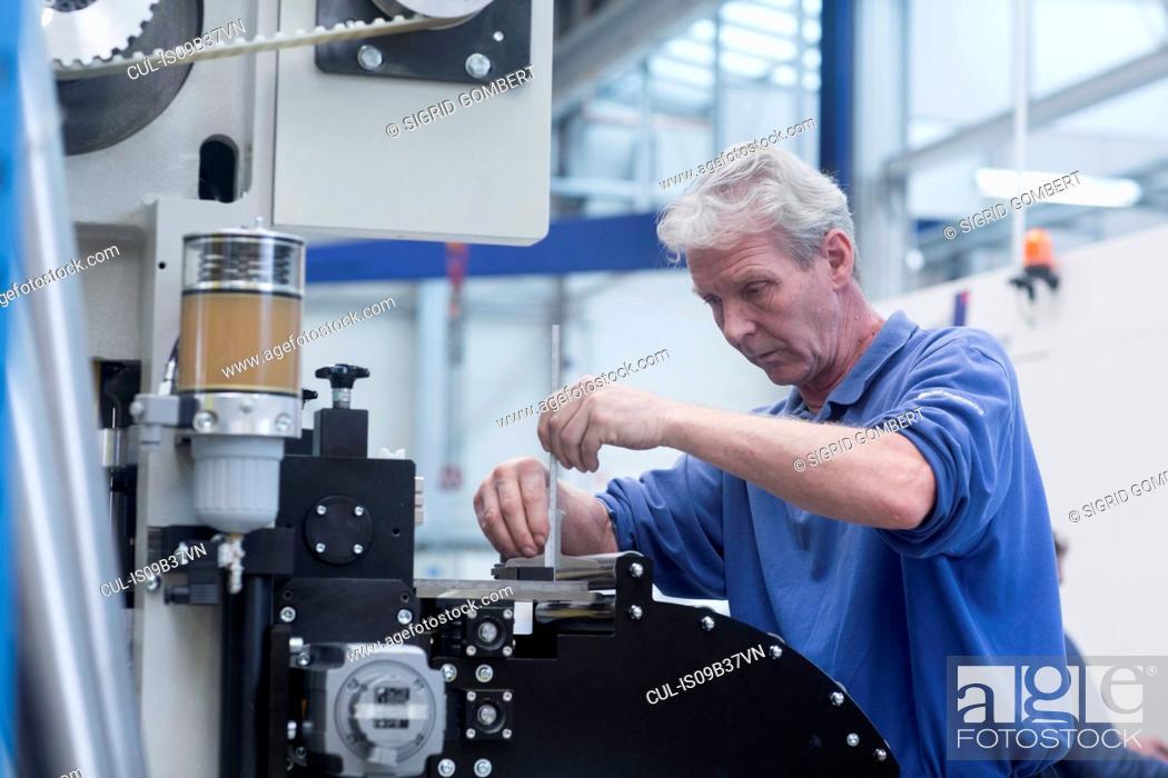Stock Photo: Engineer working in engineering plant.