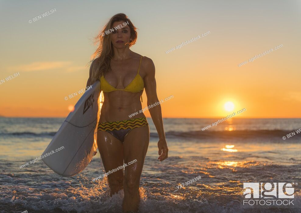 Stock Photo: Woman in bikini at the beach at sunset. Tarifa, Cadiz, Costa de la Luz, Andalusia, Spain.