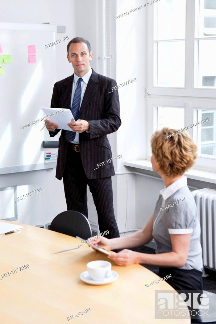 Stock Photo: A businessman leading a meeting.