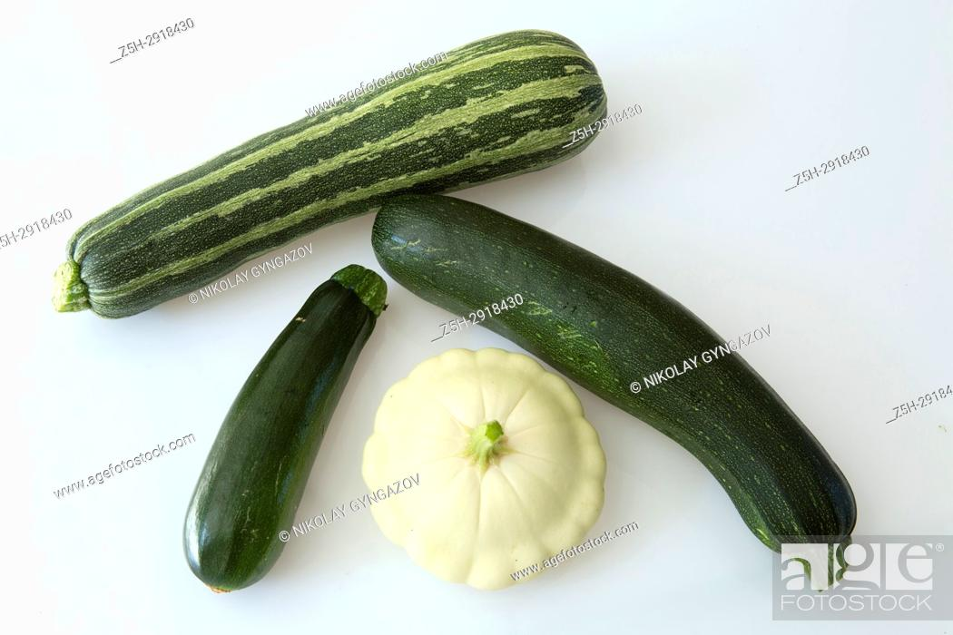 Stock Photo: Still-life of green vegetables on a white background.