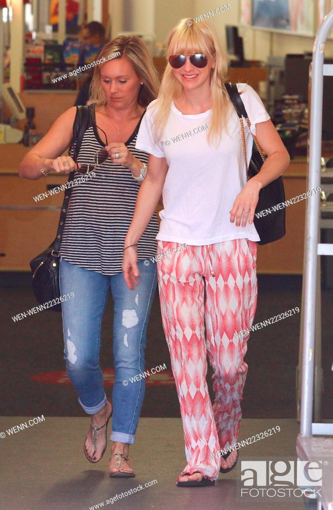 A make-up free Anna Faris out shopping with friends at CVS