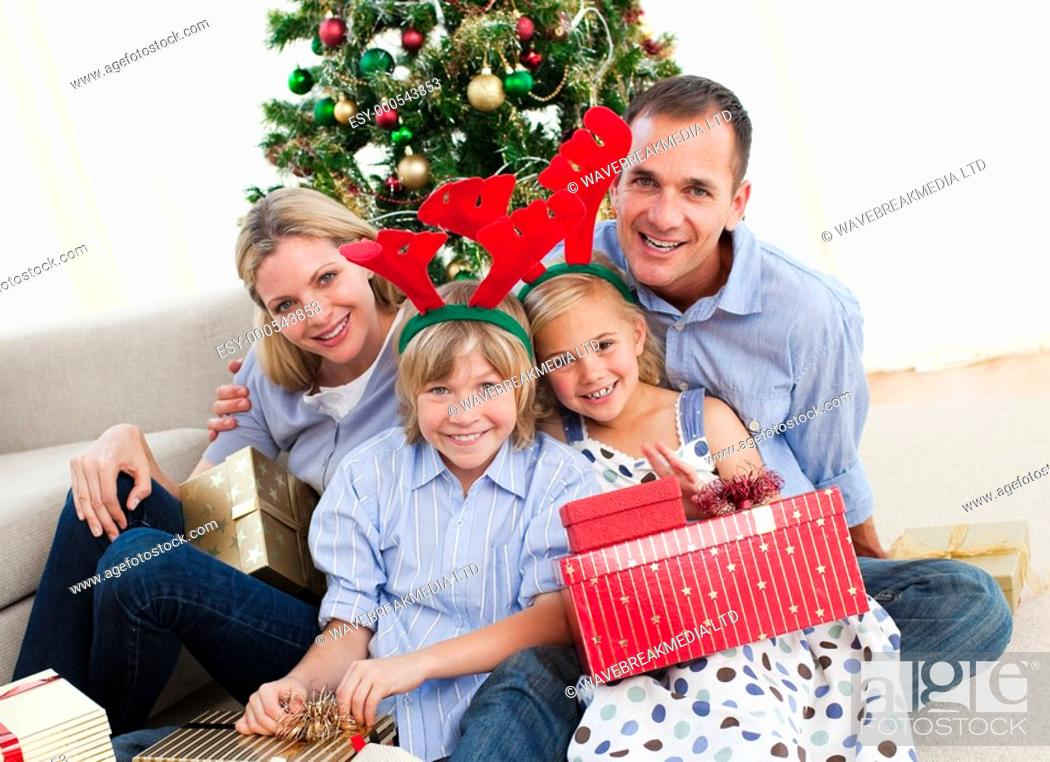 Stock Photo: Portrait of a happy family at home at Christmas time.