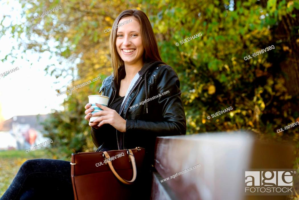 Stock Photo: Young woman on coffee break in park.