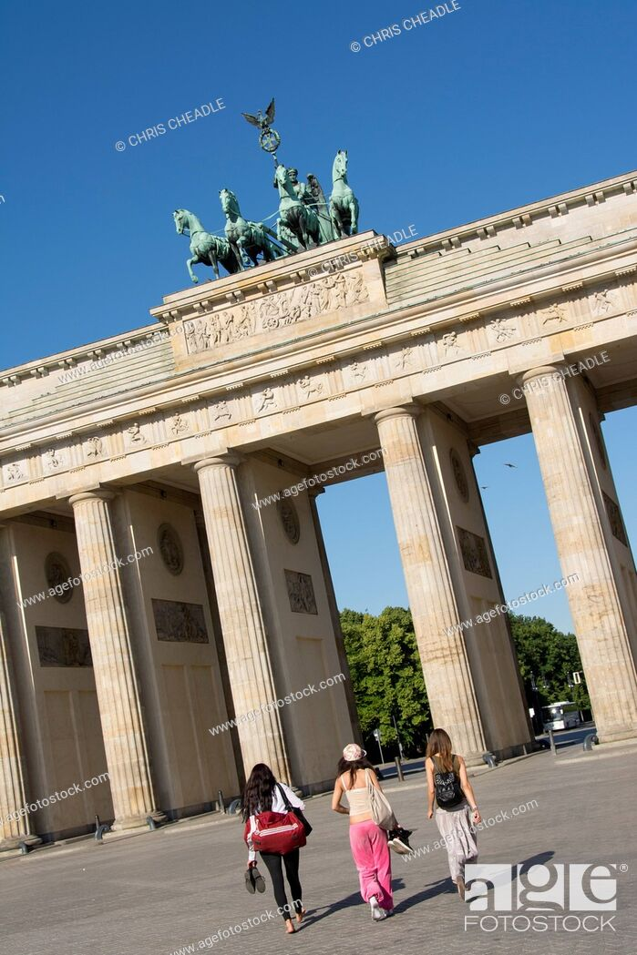 Stock Photo: People walking to The Brandenburg Gate and Quadriga which was designed by Johann Gottfried Schadow, Berlin, Germany.