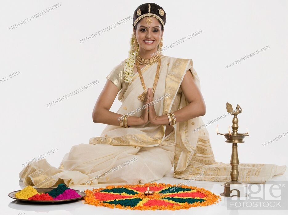 Stock Photo: Indian woman in traditional clothing praying at Durga puja festival.