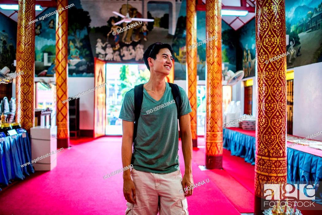 Stock Photo: Young man inside Wat Thung Yu Temple, Chiang Mai, Thailand.