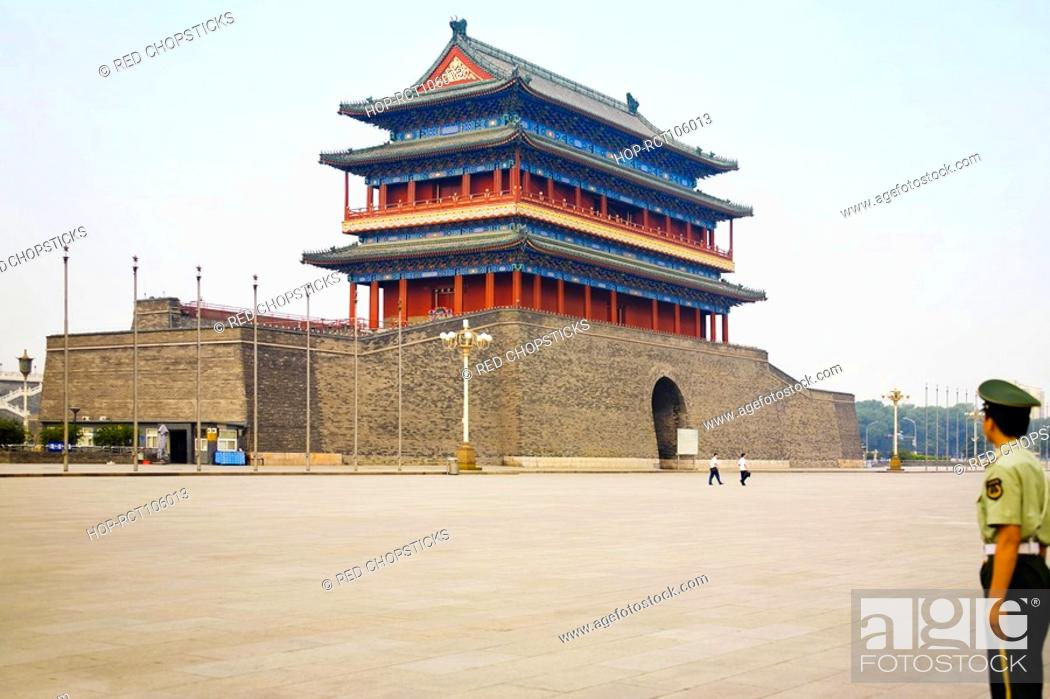Stock Photo: Police officer standing at a square, Qianmen, Beijing, China.
