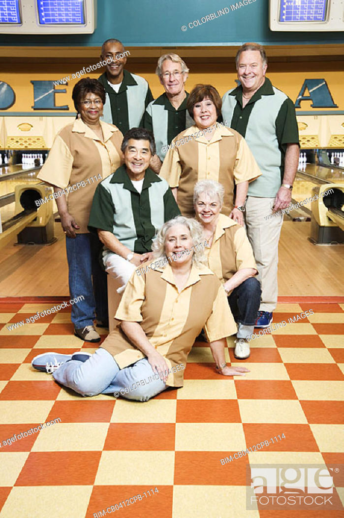 Stock Photo: Group portrait at bowling alley.