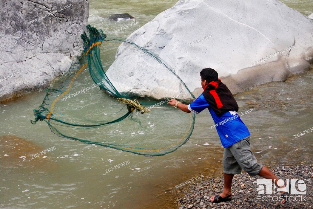 Stock Photo: Fisherman in the Rio Colca, river Colca, during the hiking in Colca Canyon, Peru.