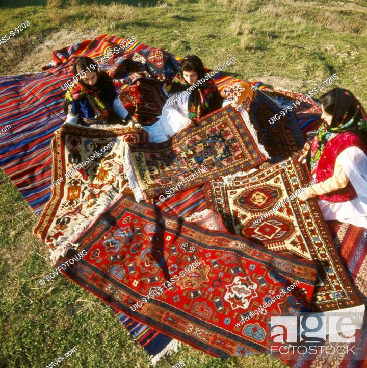Stock Photo - Carpet weavers of daghestan displaying their handicraft, russia