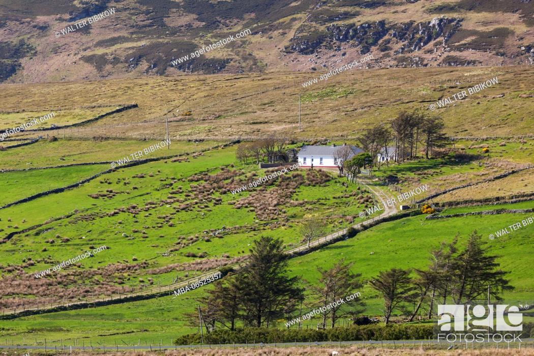 Stock Photo: Ireland, County Donegal, Glengesh Pass, landscape with traditional house.