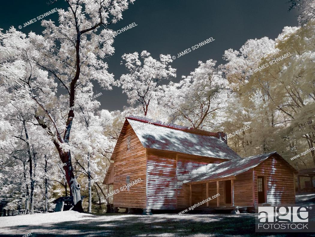 Stock Photo: Infrared red false color photography of Tipton house in Cades Cove the Great Smoky Mountains National Park in Tennessee.