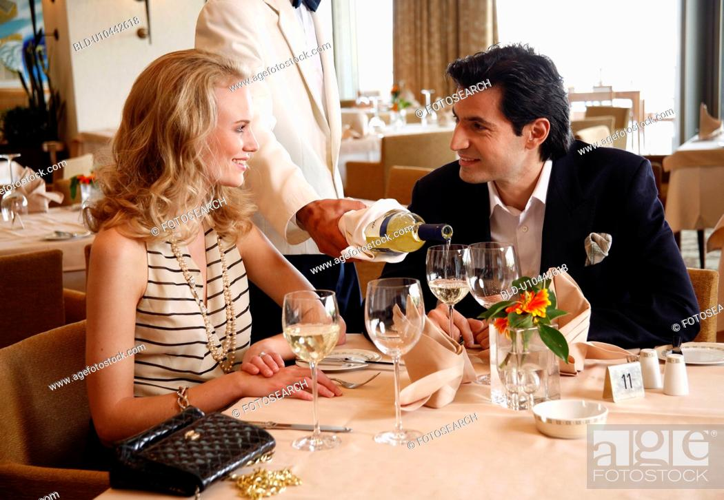 Stock Photo: Couple having a romantic moment in a restaurant.