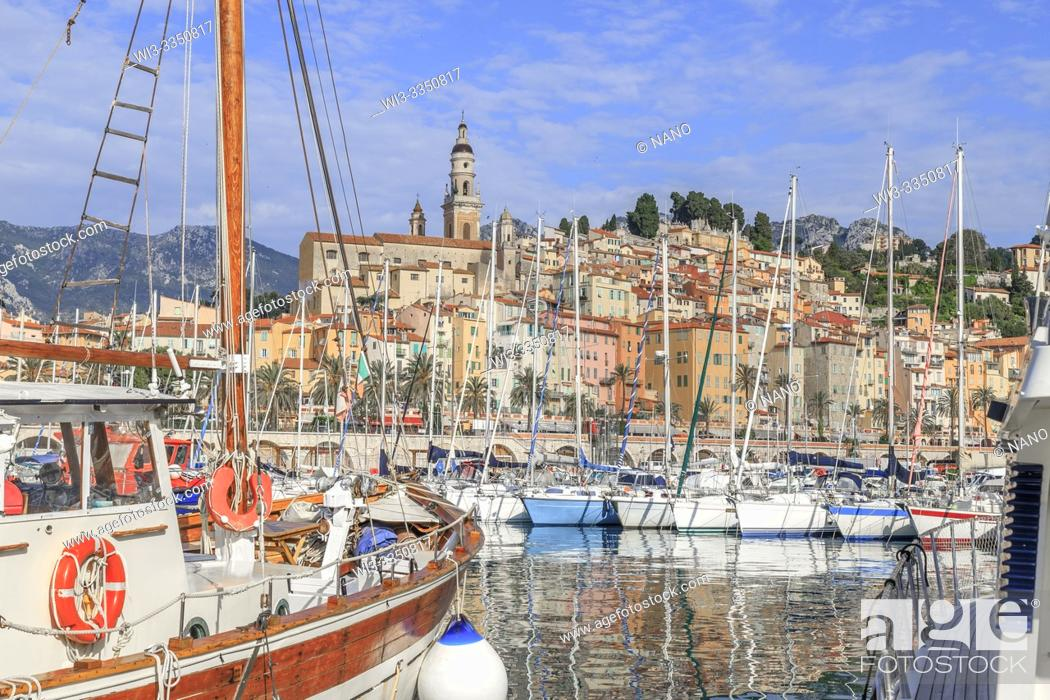 Stock Photo: France, Alpes Maritimes, Menton, the Vieux Port with sailboats and the old town dominated by the Saint Michel Archange basilica.
