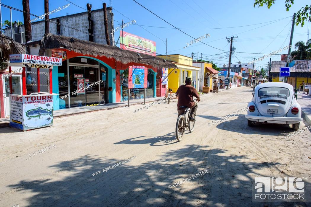 Stock Photo: Tourists in a street of Isla Holbox, Quintana Roo (Mexico).