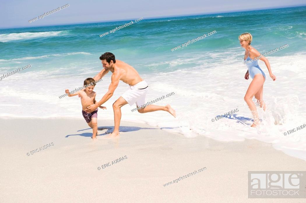 Stock Photo: Family playing on the beach.