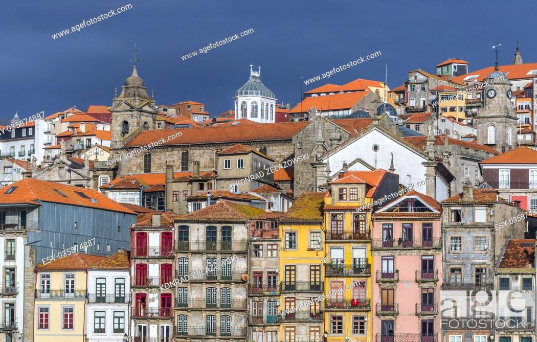 Stock Photo: Row of buildings on the Douro riverfront in Porto city, Portugal. View with Parish Church of Saint Nicholas and Saint Francis Church.