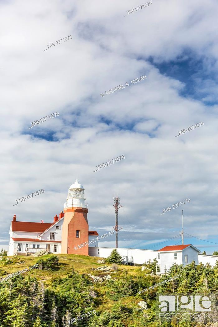 Stock Photo: Long Point lighthouse on Crow Head, North Twillingate Island off the northeast coast of Newfoundland, Canada.