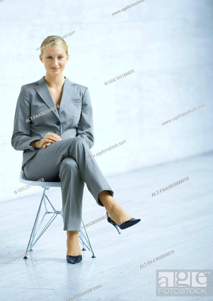 Stock Photo: Businesswoman sitting in chair, full length.