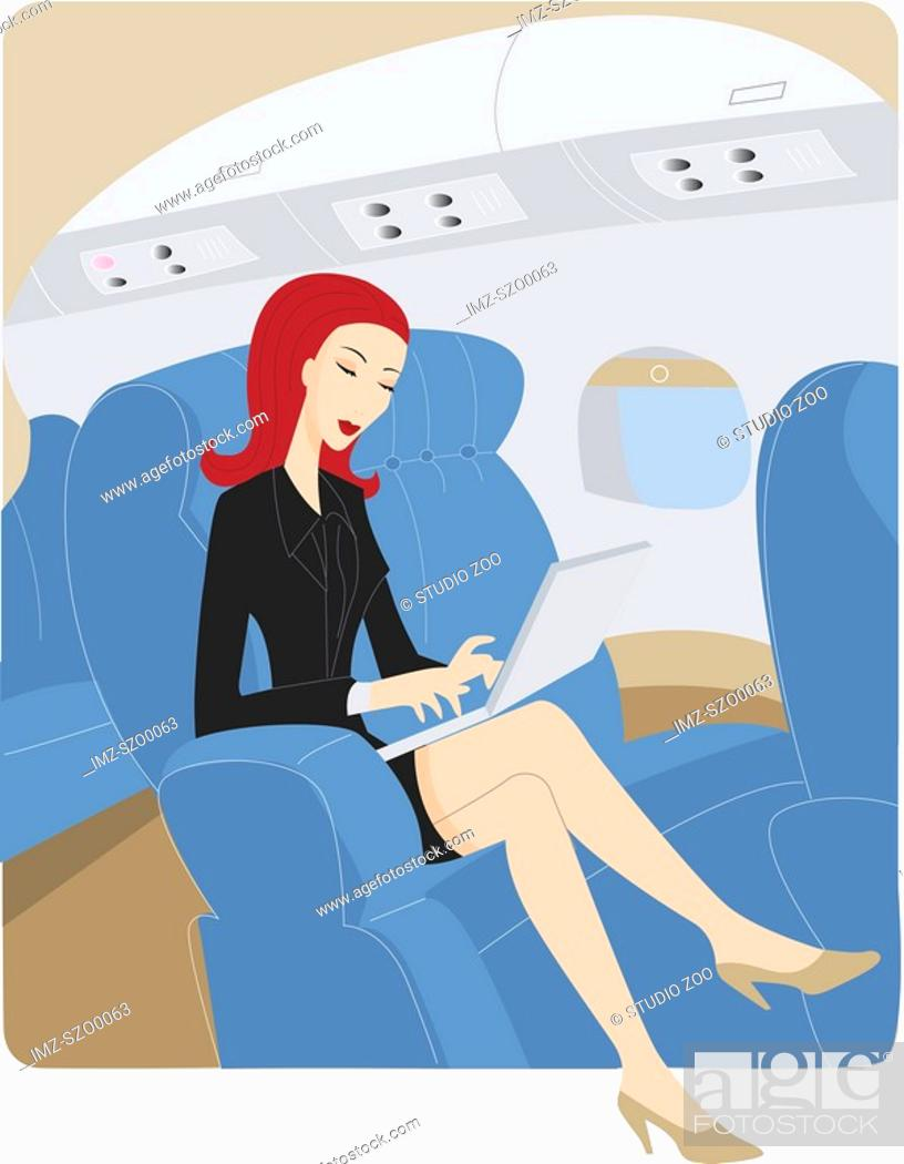 Stock Photo: Businesswoman using a laptop while on an airplane.
