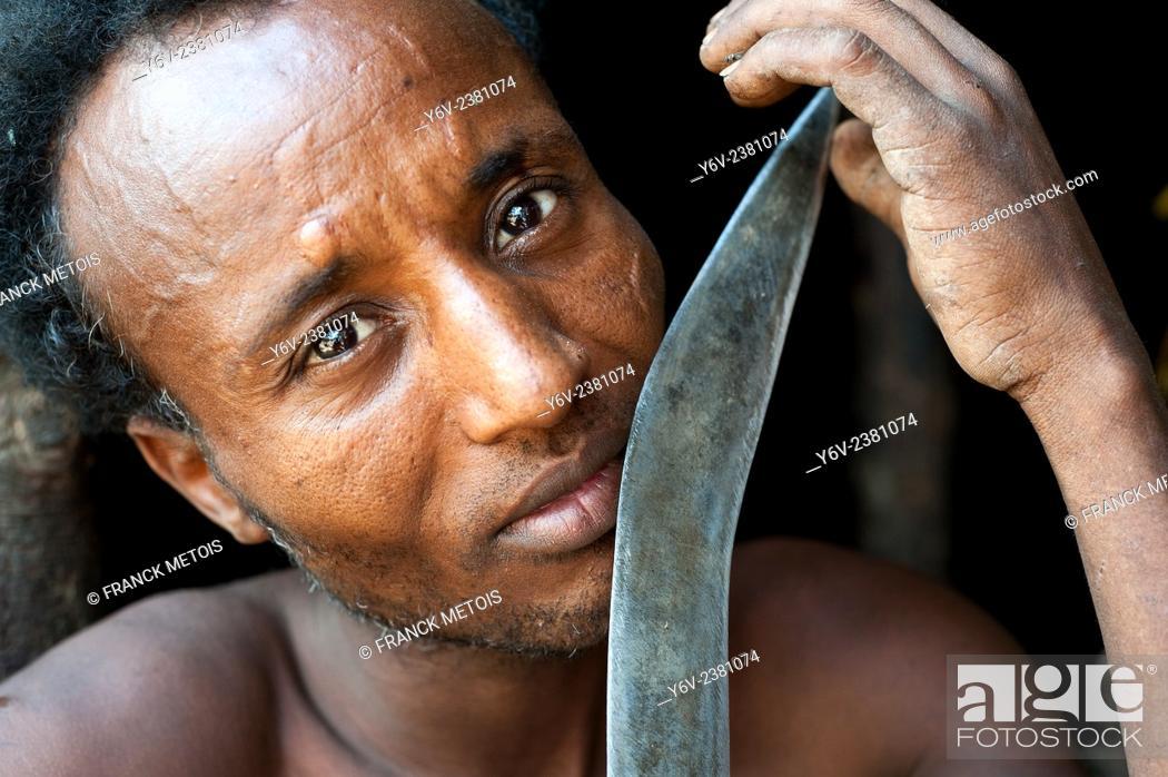 Stock Photo: Man belonging to the Kereyu tribe holding his knife ( Ethiopia).