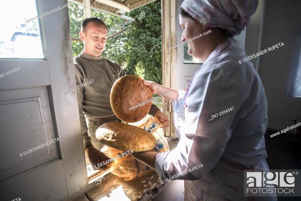 Stock Photo: Workers of the Nikitin Kolkhoz bakery prepare bread, Ivanovka village, Azerbaijan. Bakery makes bread for local people. Children from school and kindergarden of.