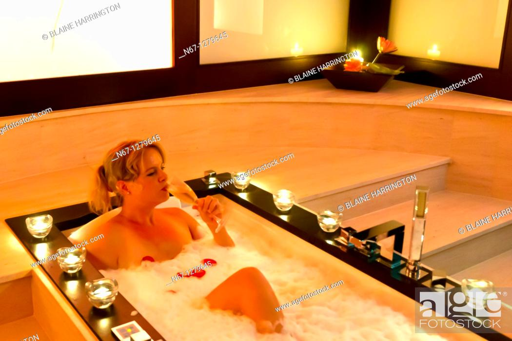Stock Photo: A woman relaxing in a bath tub with rose pedals, Futeresse suite in the spa, Brenner's Park Hotel & Spa, Baden Baden, Baden-Württemberg, Germany.