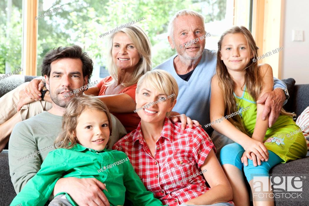 Stock Photo: Germany, Bavaria, Numerberg, Portrait of family in living room.