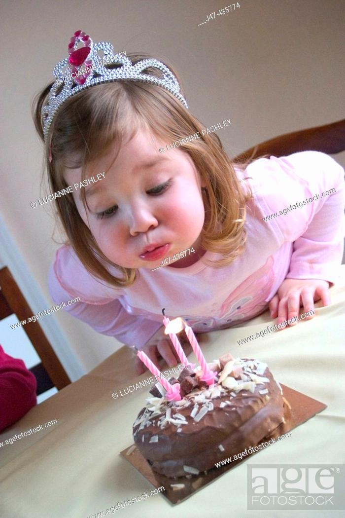 3 Year Old Girl Blowing A Candle Out On Her Birthday Cake Cake