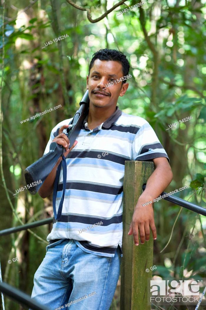 Stock Photo: Young man with shotgun.
