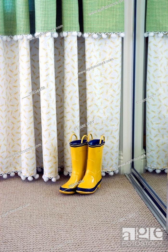 Stock Photo: Yellow boots in mirror.
