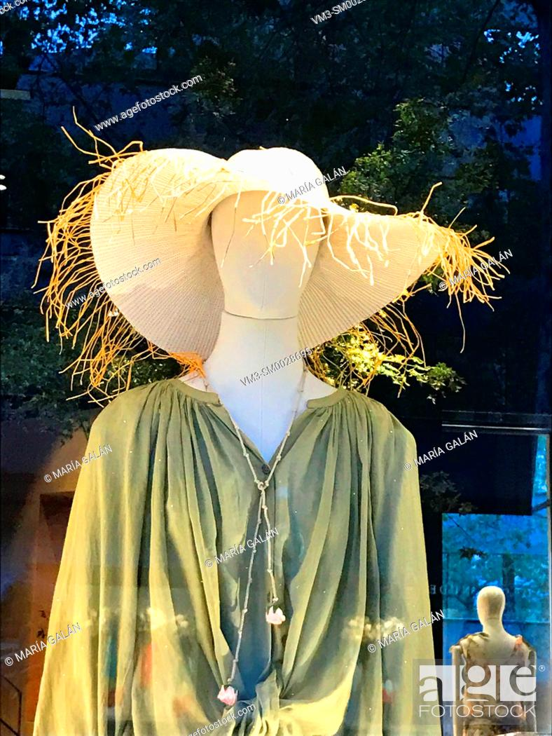Stock Photo: Mannequin wearing sun hat in a shop window. Madrid, Spain.
