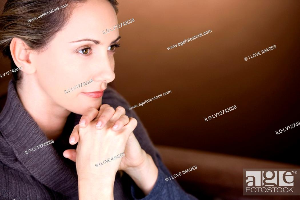 Stock Photo: Portrait of a mid adult woman thinking.