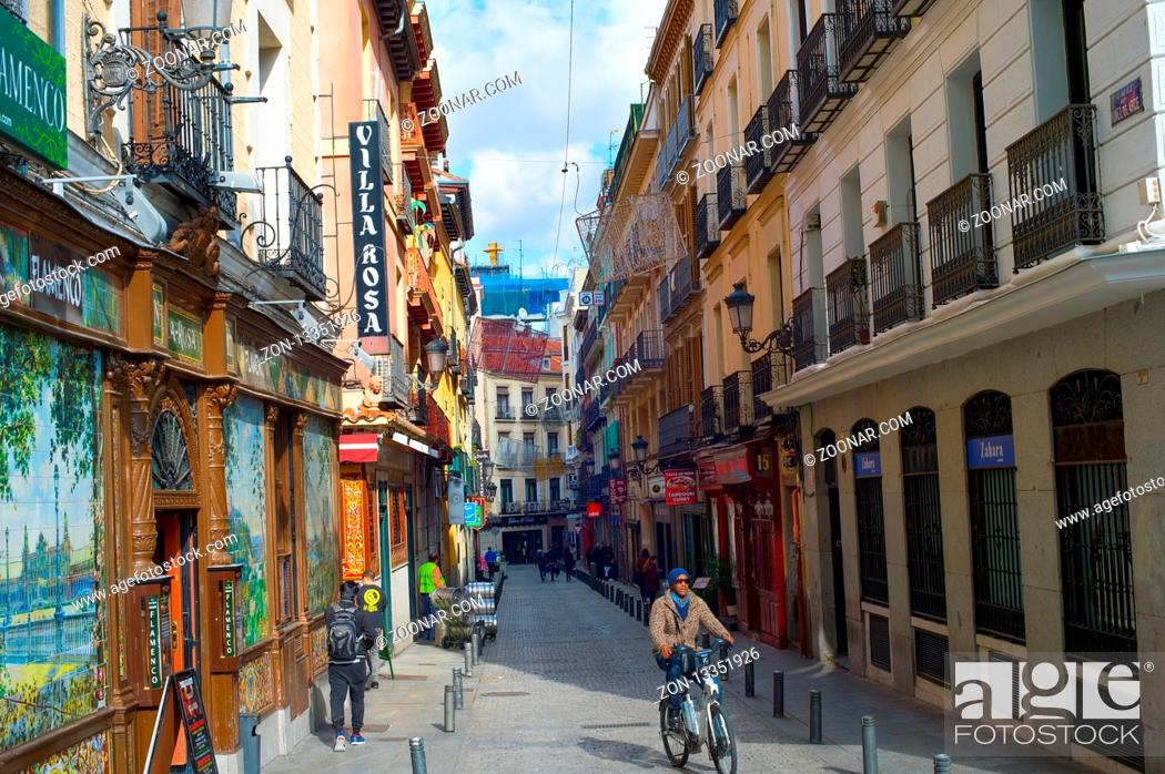Stock Photo: MADRID, SPAIN - NOVEMBER 07, 2016: People at an Old Town street in Madrid. Madrid is the capital of Spain.