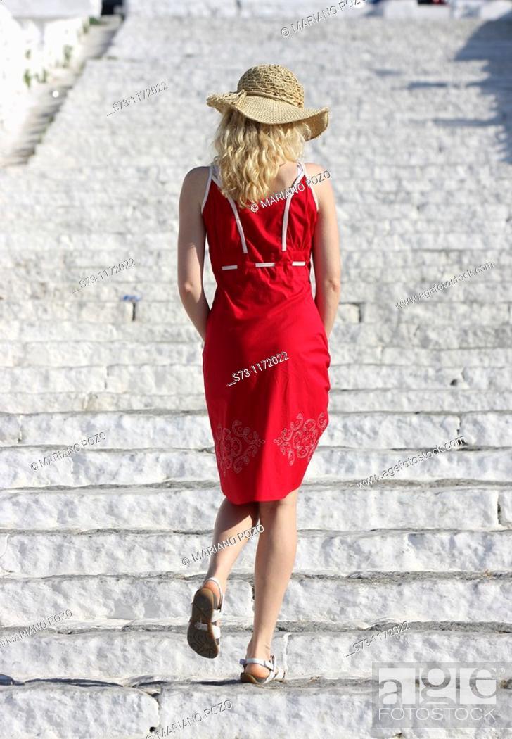 Stock Photo: Woman walking in Mykonos, Greek Islands, Greece.