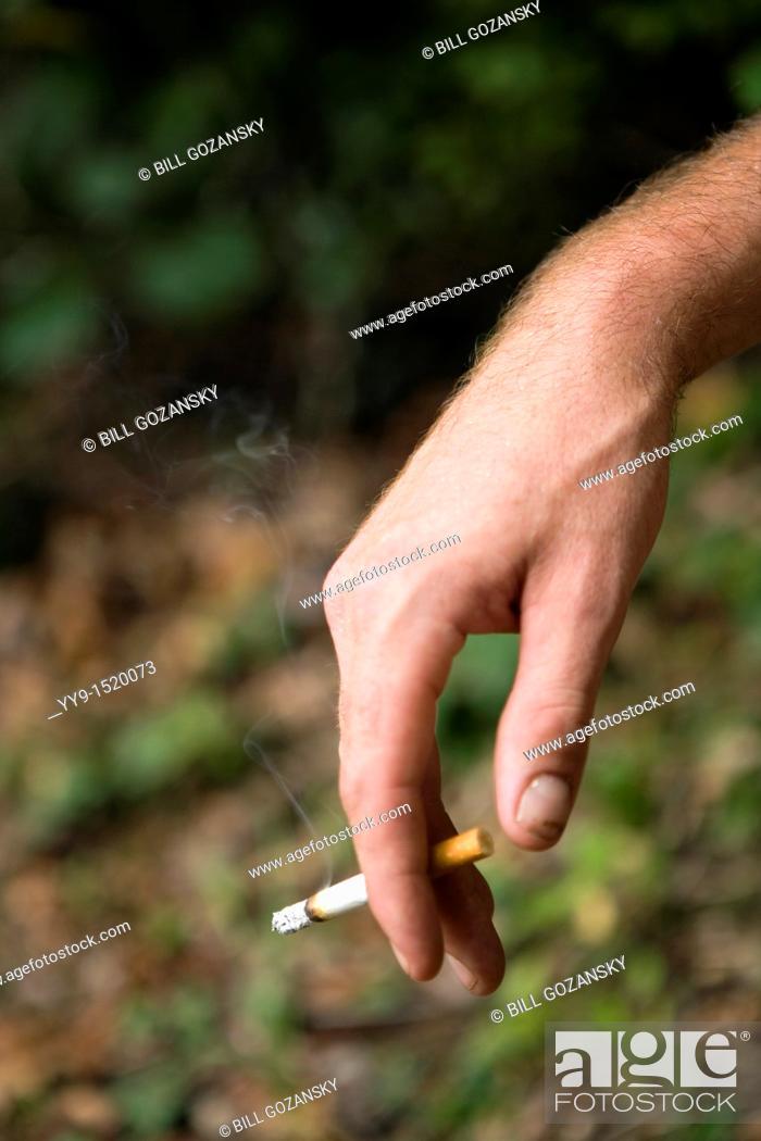 Stock Photo: Close-up of hand with cigarette - Cedar Mountain, North Carolina, USA.