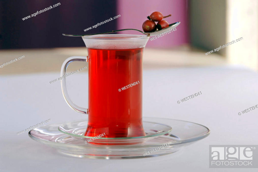 Stock Photo: Rose hip tea in glass.